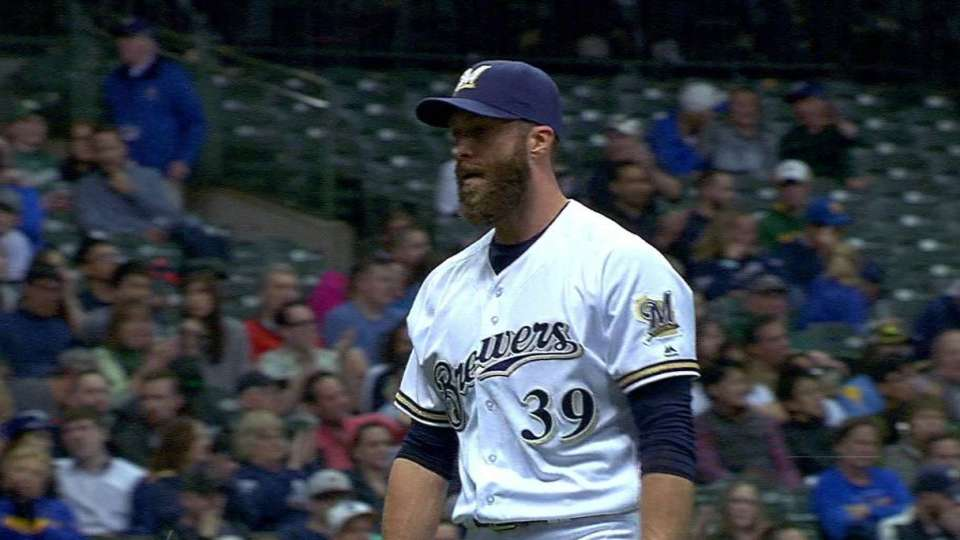 Capuano ends bases-loaded threat