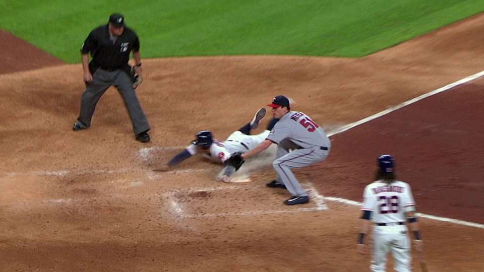 Springer scores on a wild pitch
