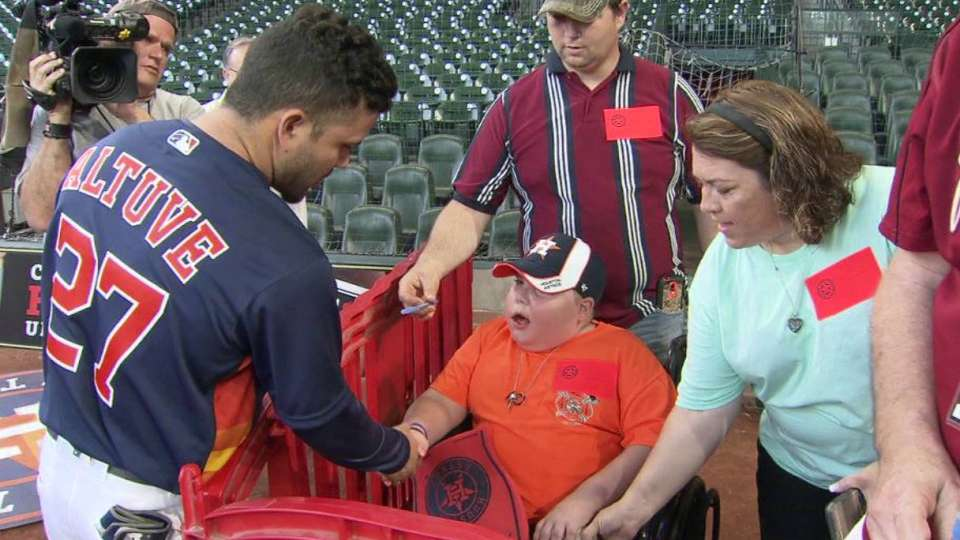 Altuve and Correa sign autograph
