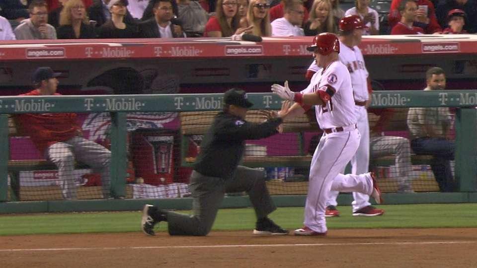Trout runs over umpire