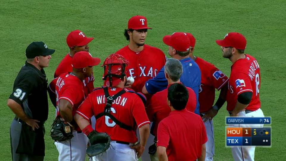 Darvish gets looked at, exits