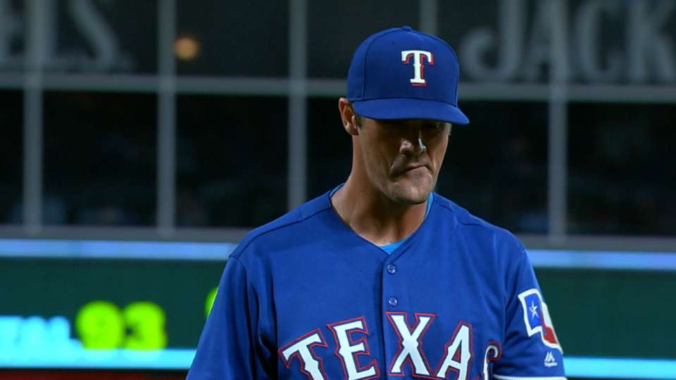 Hamels strikes out eight