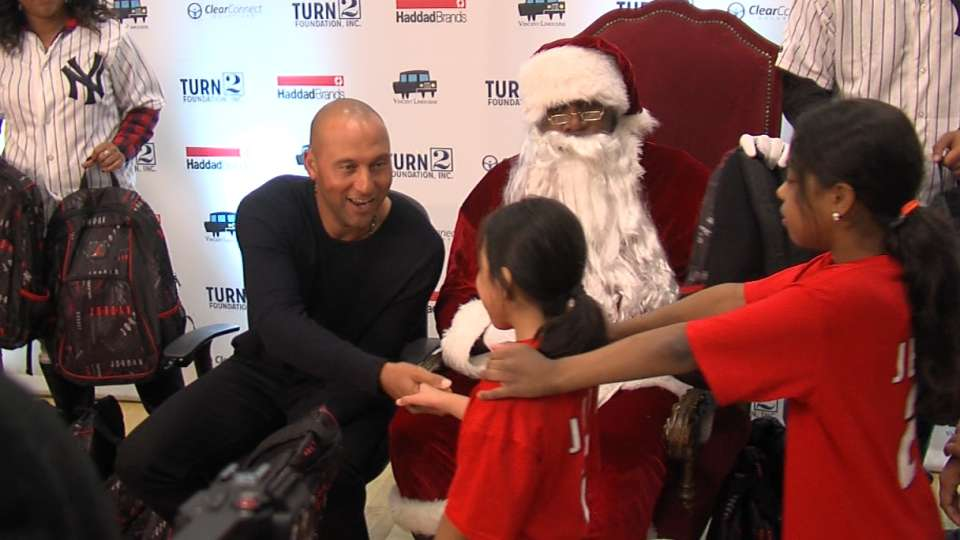 Jeter hands out gifts to kids