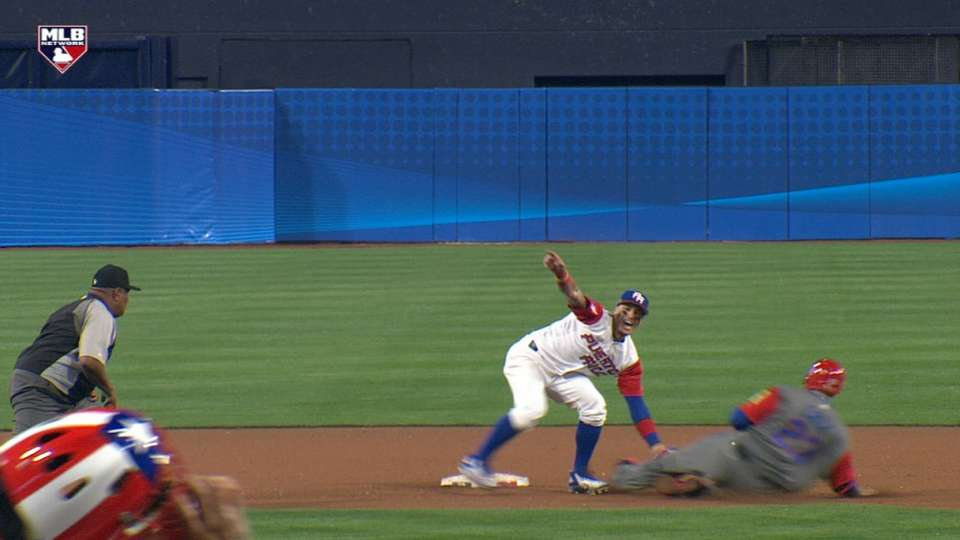 Baez's no-look tag, celebration