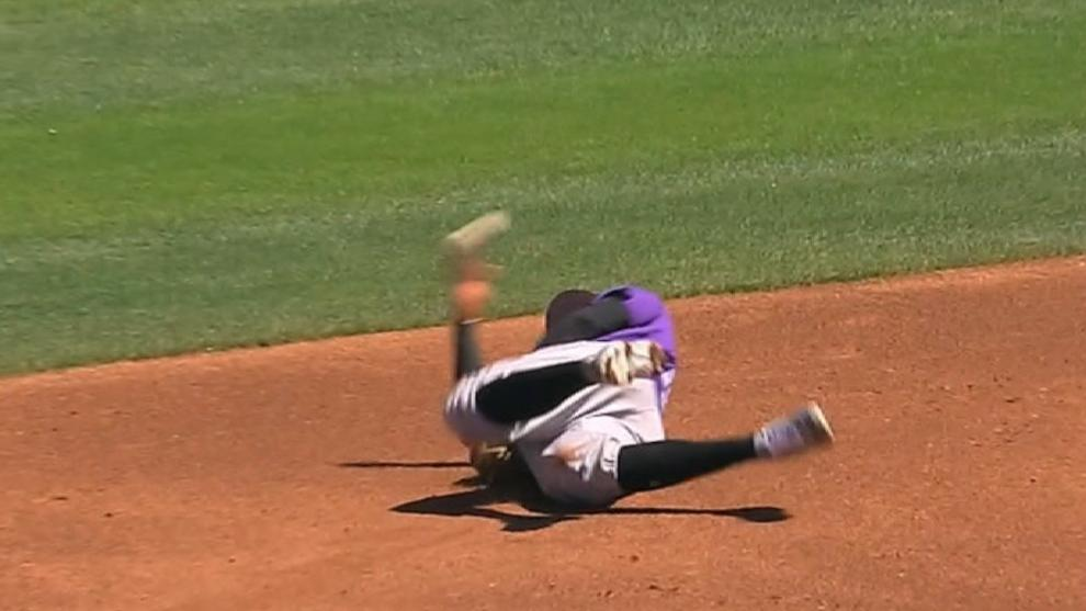 Trevor Story is trying to improve his defense, and this rolling, backwards throw is a good start