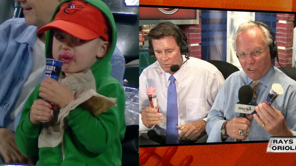 Fan, announcers enjoys popsicle