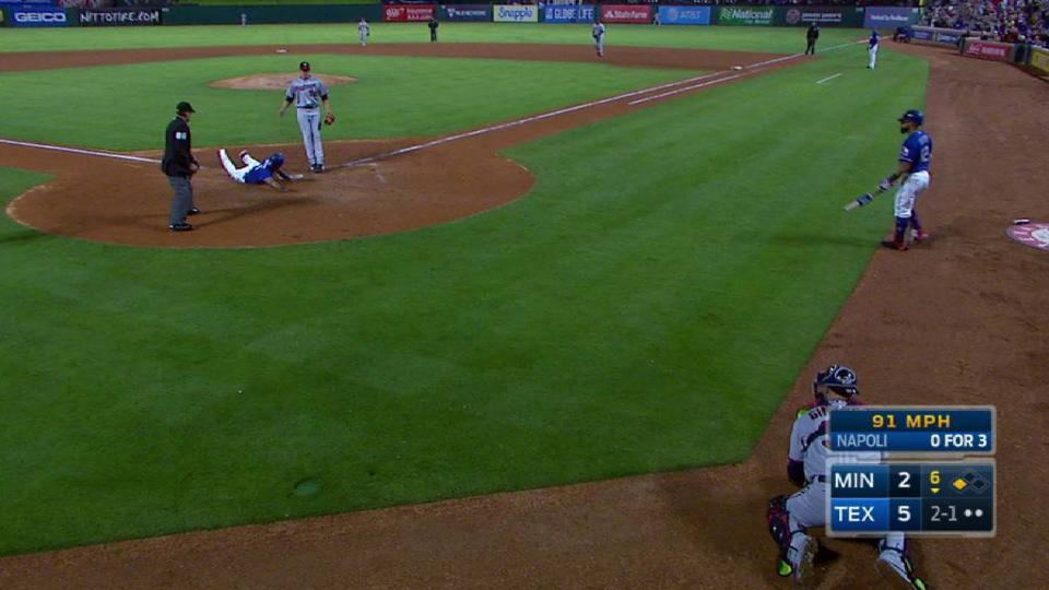 Andrus scores on a passed ball