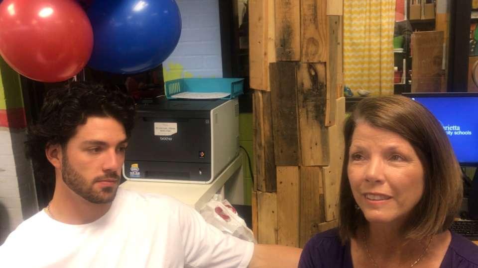 Swanson surprises mom at work