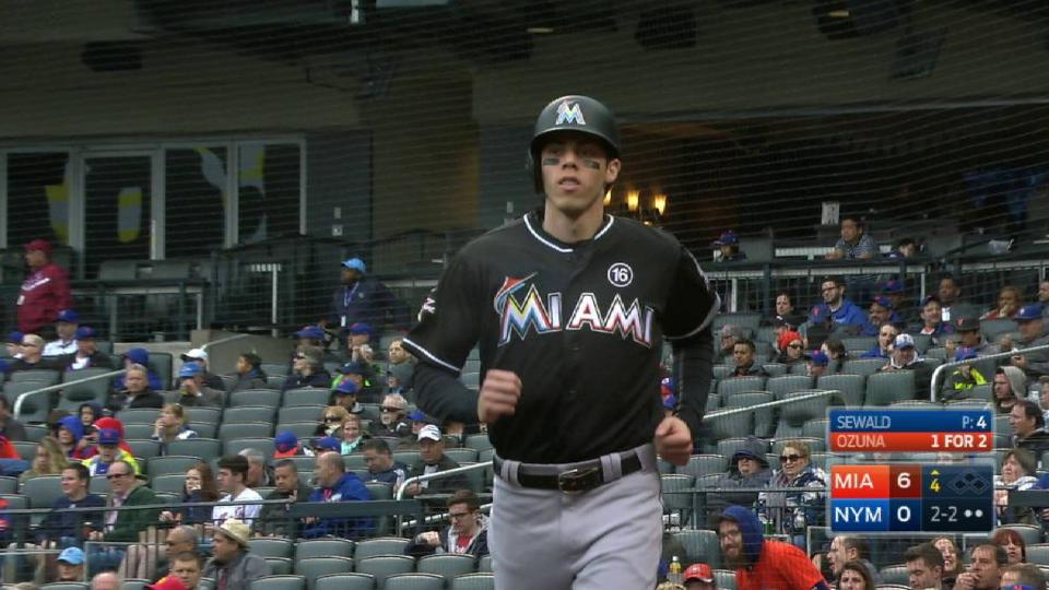 Yelich scores on a wild pitch