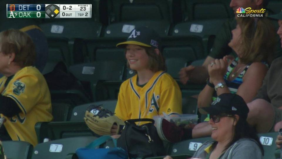 Young A's fan's nice catch