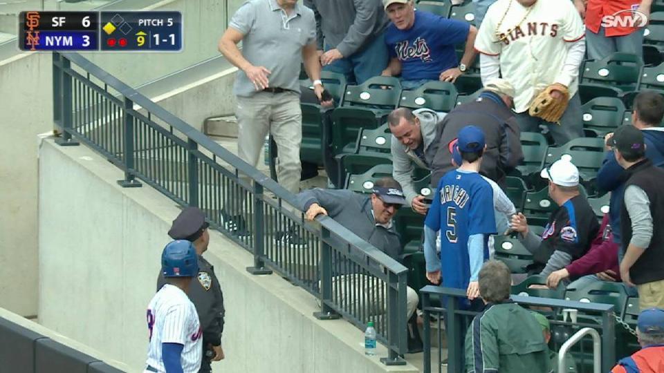 Fan falls trying to catch ball