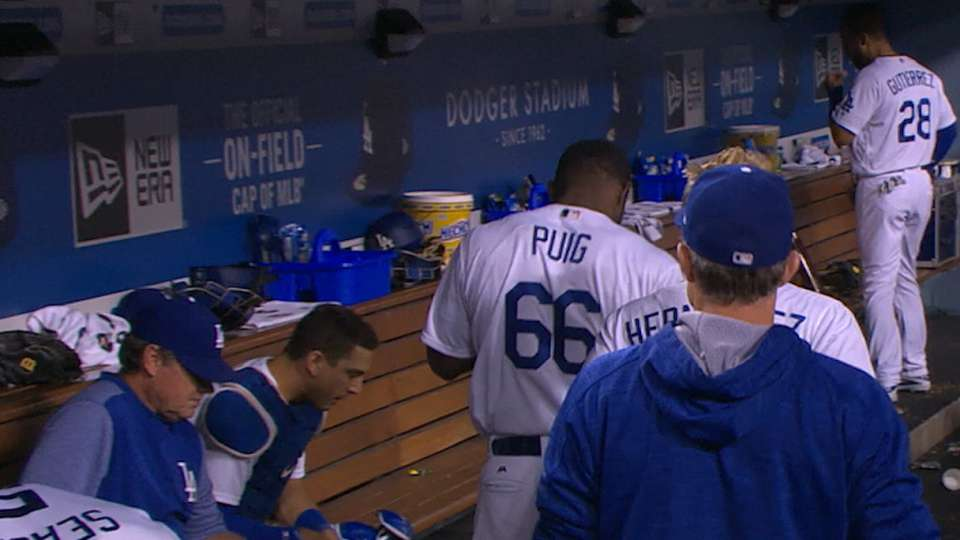 Puig exits with tight back