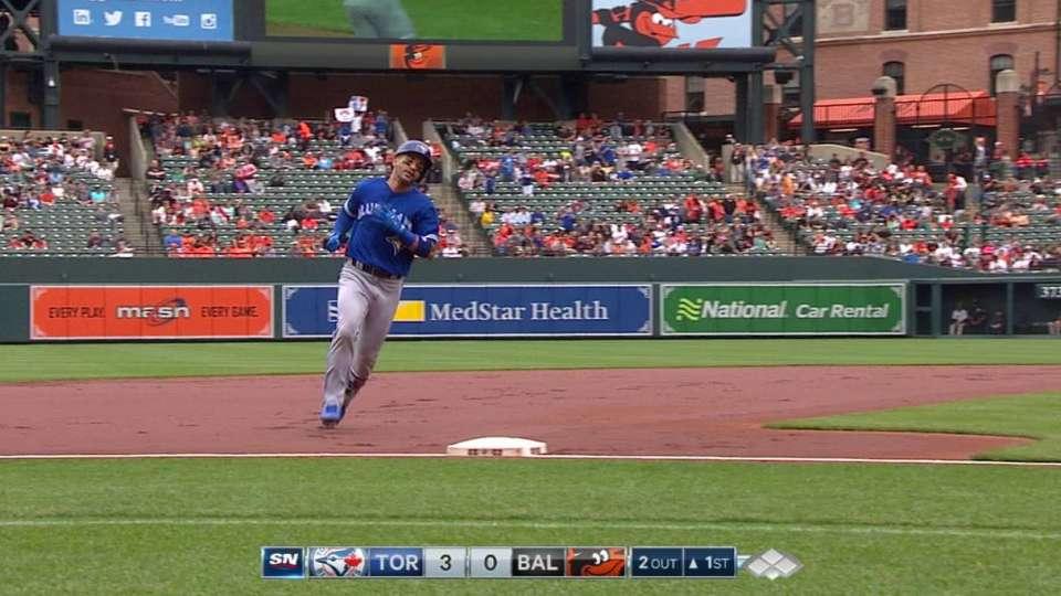 Travis' three-run home run