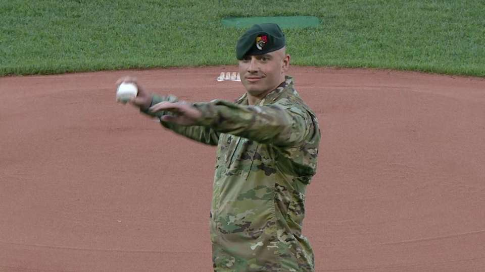 Sgt. Nick Lavery tosses pitch