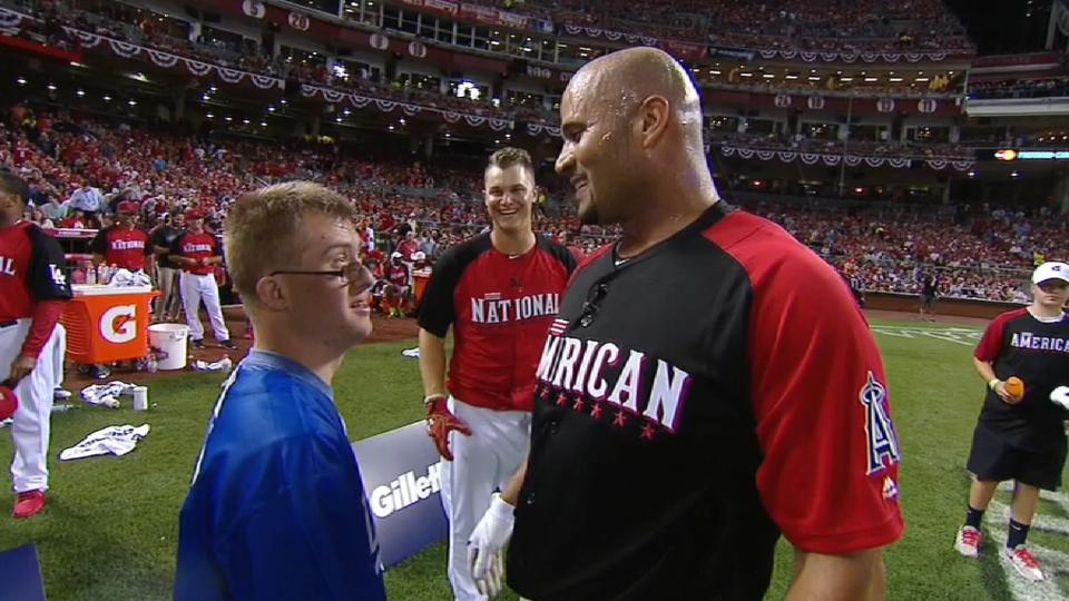 Pujols and Champ hug it out