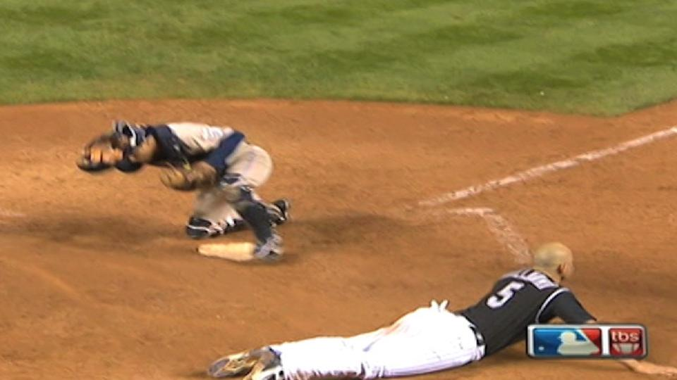 Holliday slides home
