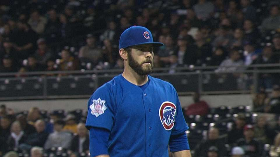 Arrieta wins first game of 2014