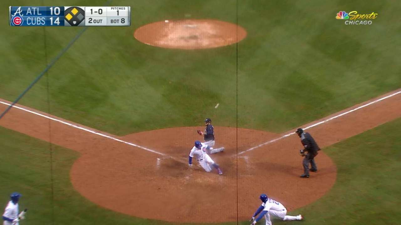 Cubs score on wild pitch, error