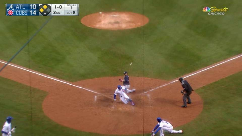 Cubs score on wild pitch, error