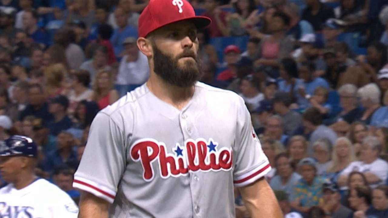 Arrieta earns first Phils win