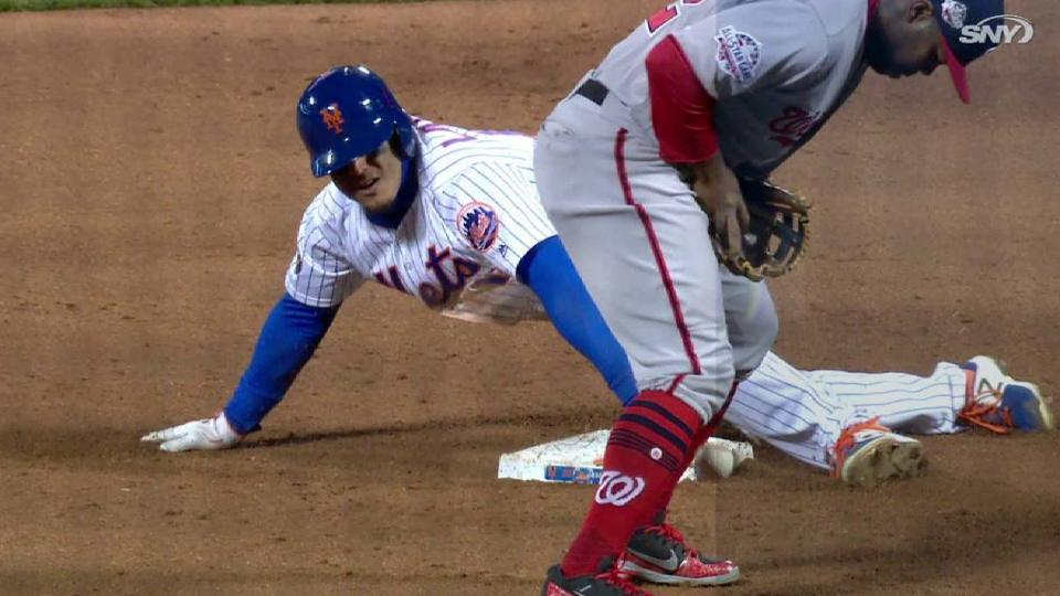 Lagares swipes second base
