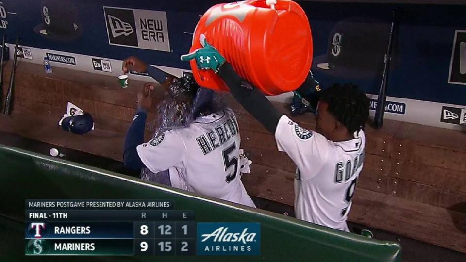 Heredia gets doused in dugout