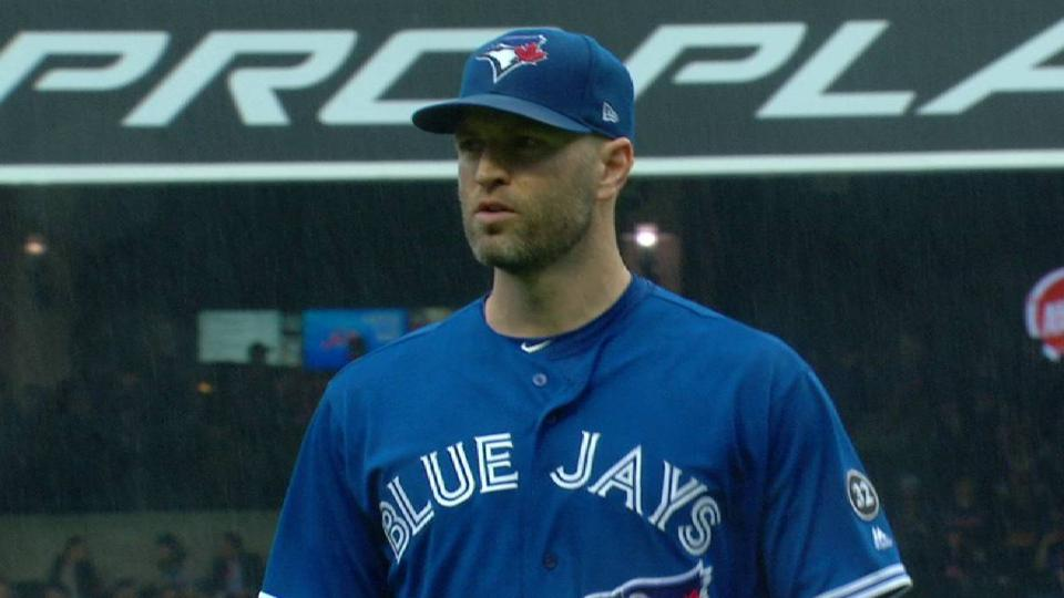 Happ strikes out the side