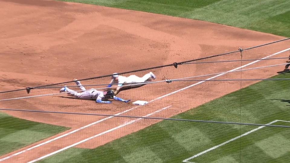 Devers dives back to first