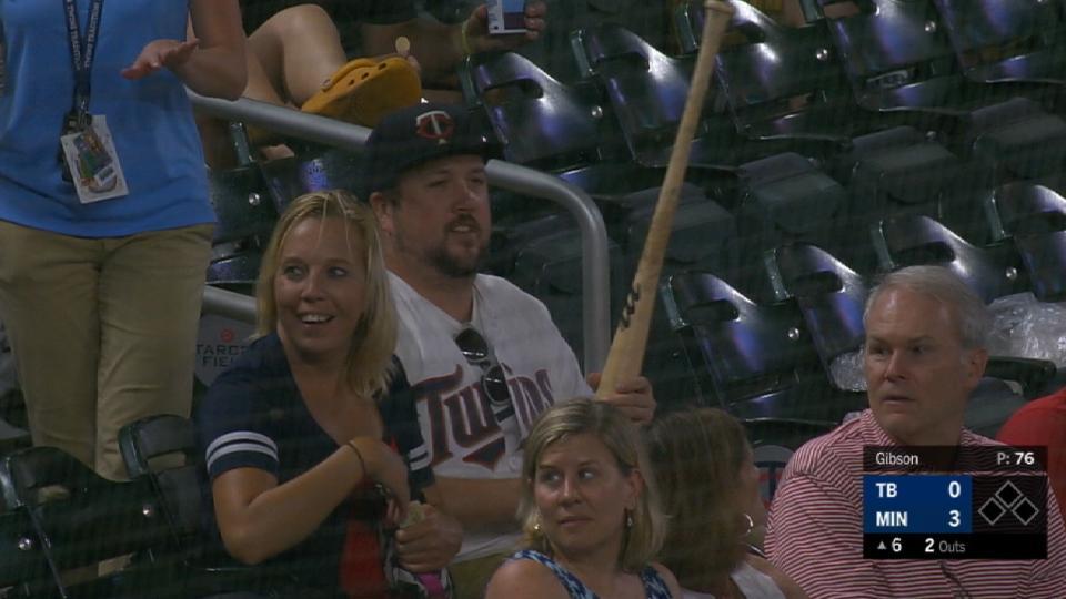 Fan snatches up loose bat
