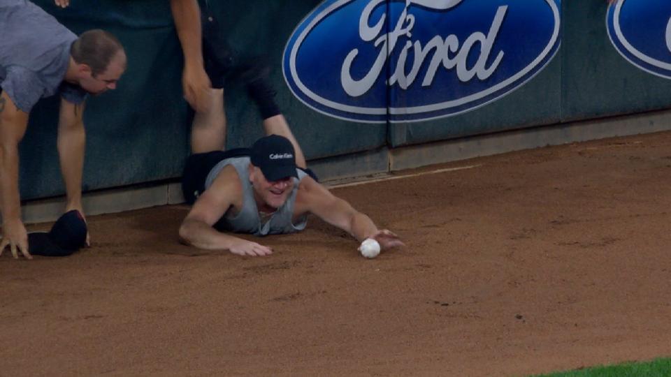 Fan falls on field getting ball