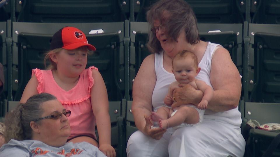 Adorable baby watches the game