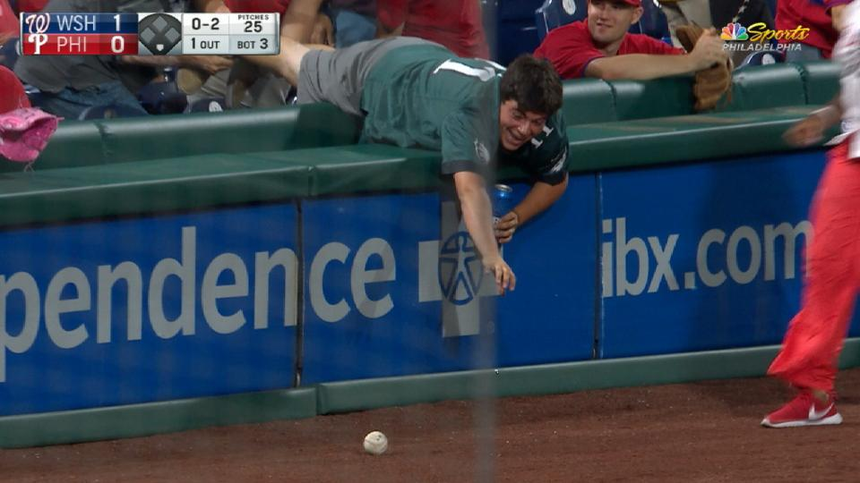 Philly fan keeps beer, foul ball