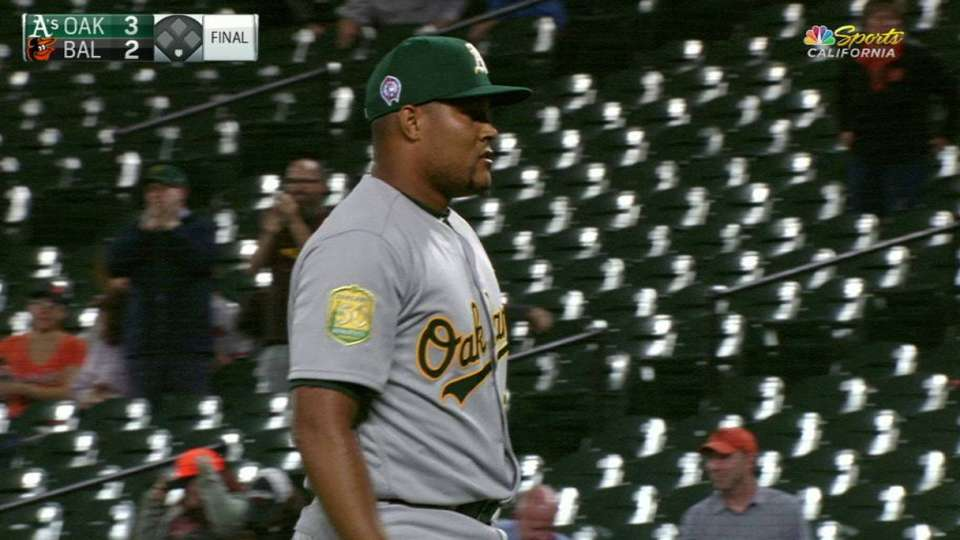 Familia earns 1st save with A's