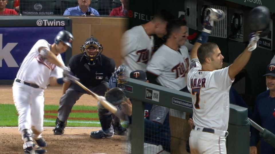 Mauer's grand slam to center