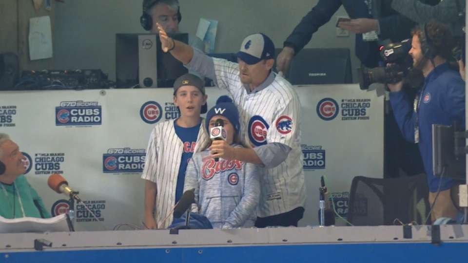 Kerry Wood sings during stretch