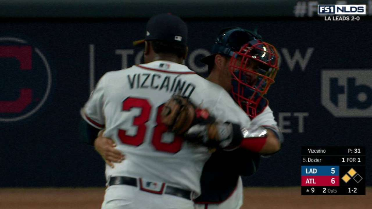 Vizcaino K's Dozier, earns save